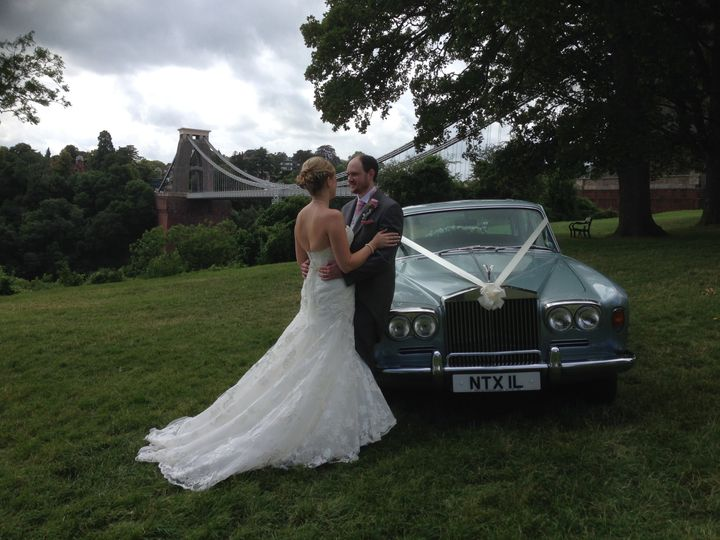 Bride and groom with Rolls