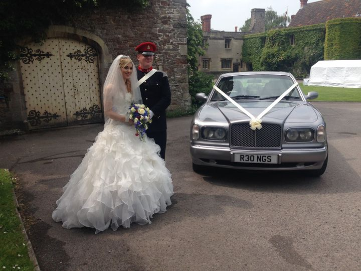 Bride and Groom with Bentley
