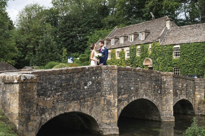 Couple standing on a stone bridge