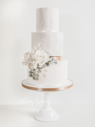Grey marble and copper floating tier wedding cake