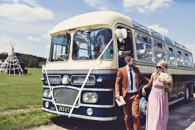 Vintage bus dropping off guests