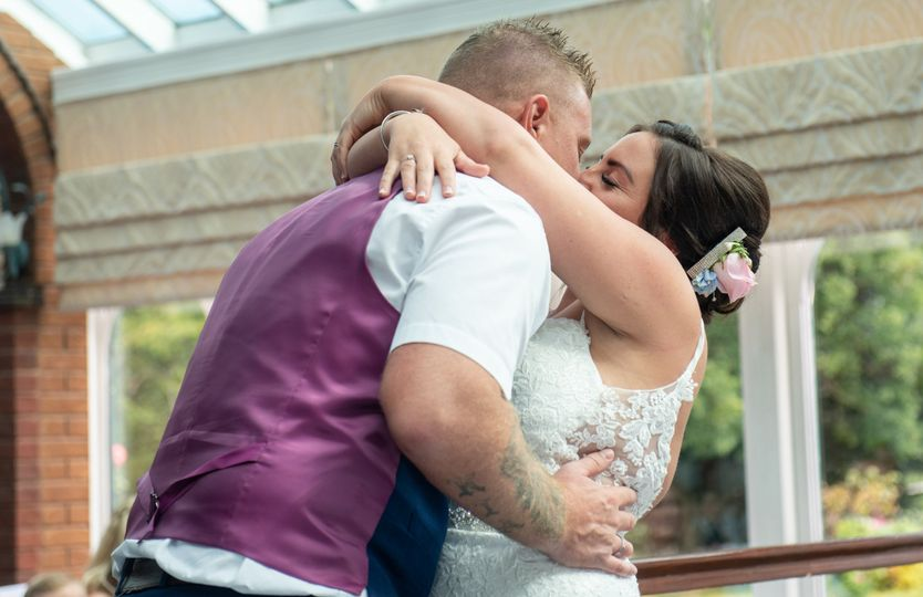 First kiss as a married couple - AR Wedding Photography