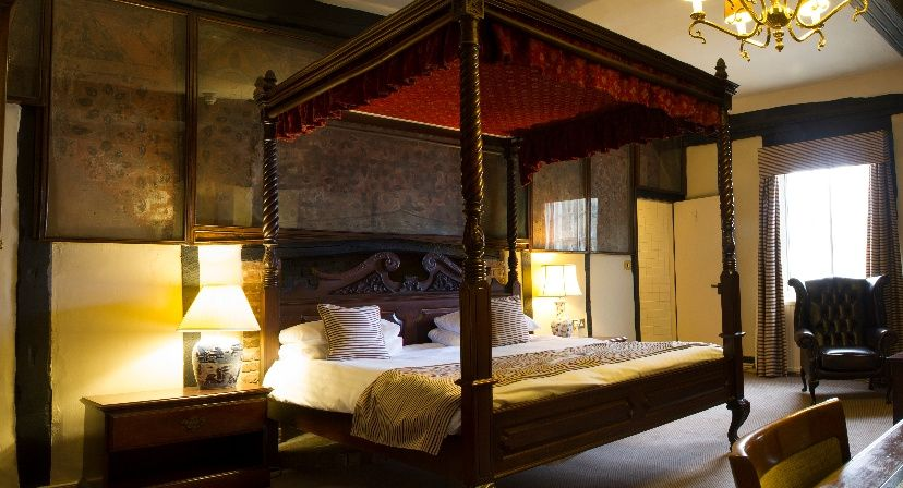 Luxury four-poster room at The Bell Hotel