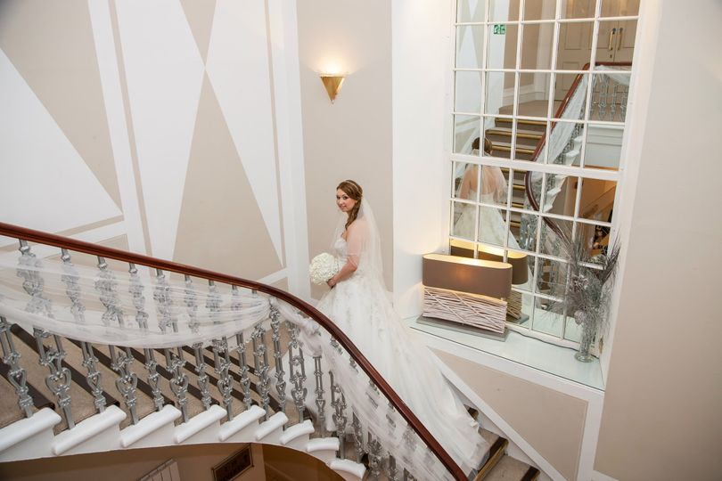 Bride on stairs - reflection
