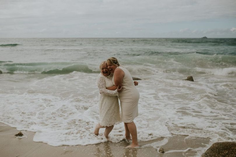 Newlyweds cuddling after ceremony
