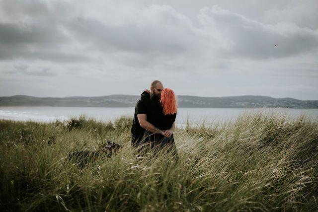 Hugging in long grass