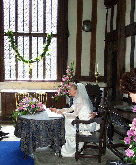 Bride and Groom signing the marriage register in the Tudor Great Hall