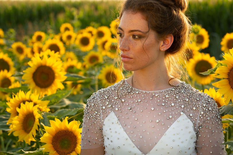 Newlywed in a field of sunflowers