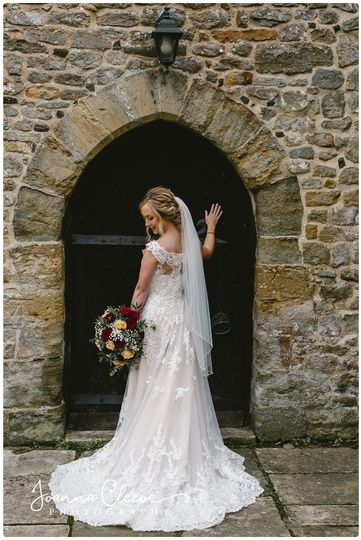Bride holding a bouquet - Joanna Cleeve