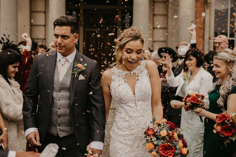 Newlyweds in confetti - Twigs Branch Photography
