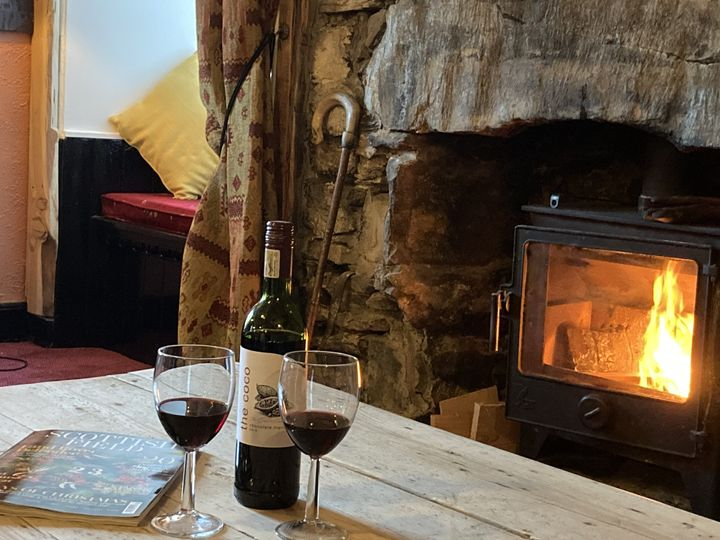 Library Lounge with cosy log burner