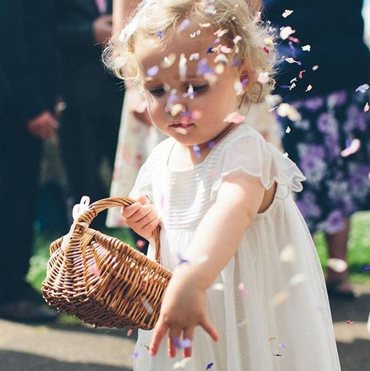Flowergirl with Rainbow Delphinium Petals. The Real Flower Petal Confetti Company
