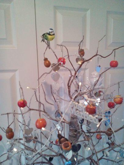 Tree with acorns apples birds