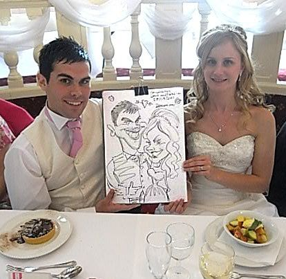 Caricature of the Bride and Groom at the head table