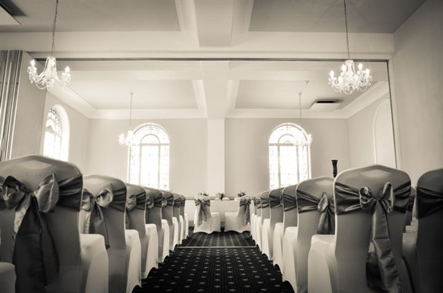 Ceremony room with stained glass windows and chandeliers