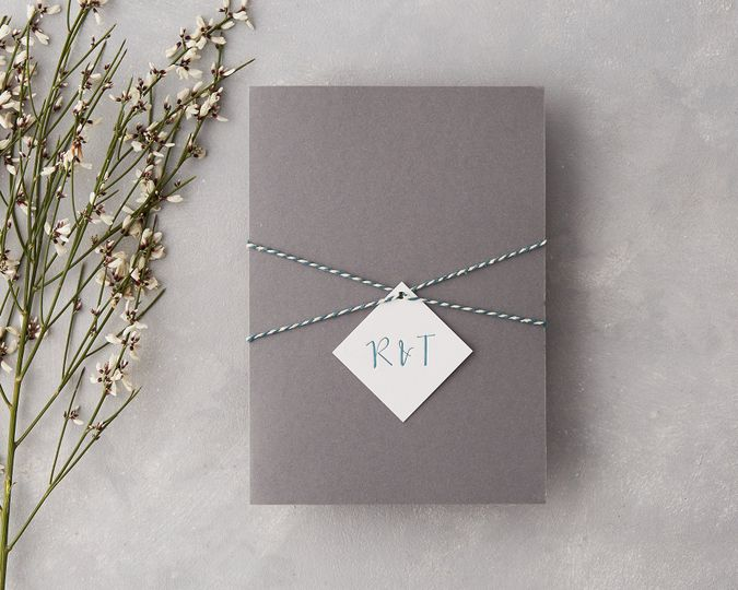 Pocketfold wedding invitation with tag