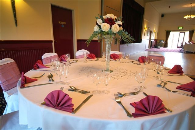 Place settings and floral centrepiece