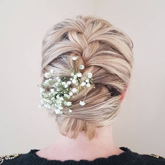 Intricate updo with hair florals