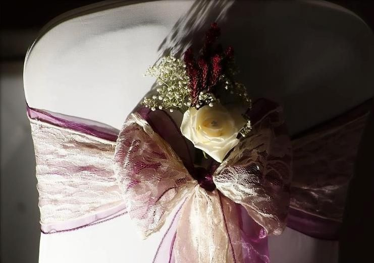 Plum sash with lace and flower