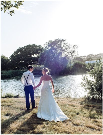 Holding hands by the water