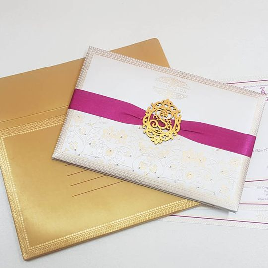 Gold seal with pink ribbon