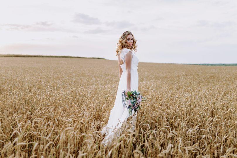Bride standing in a field