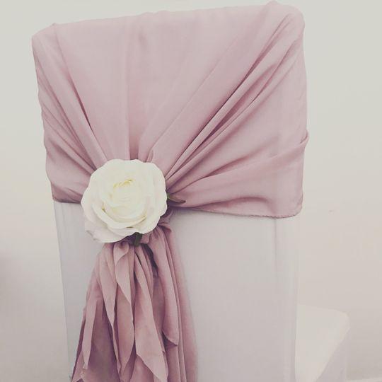 Chiffon chair hood with rose