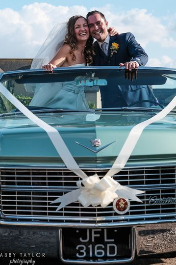 Couple in the wedding car - Abby Taylor Photography