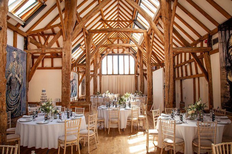Aisled Barn set up for Louise & Richards wedding breakfast