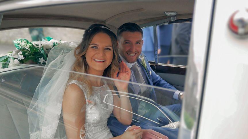Newlyweds in the wedding car
