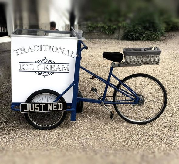 Ice cream trike with just wed signage
