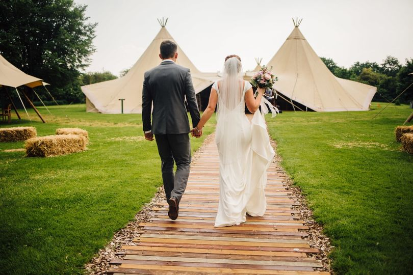 Bride and groom at the tipi