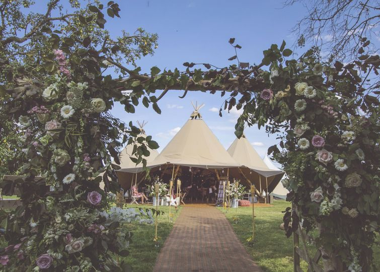 Tipis and floral arches