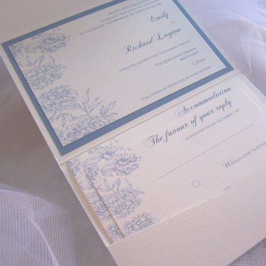 Pocketfold inner features invitation layer and information cards with coordinating graphic print and...