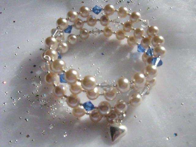 Memory wire bracelet with vintage pearls, crystals and sterling silver