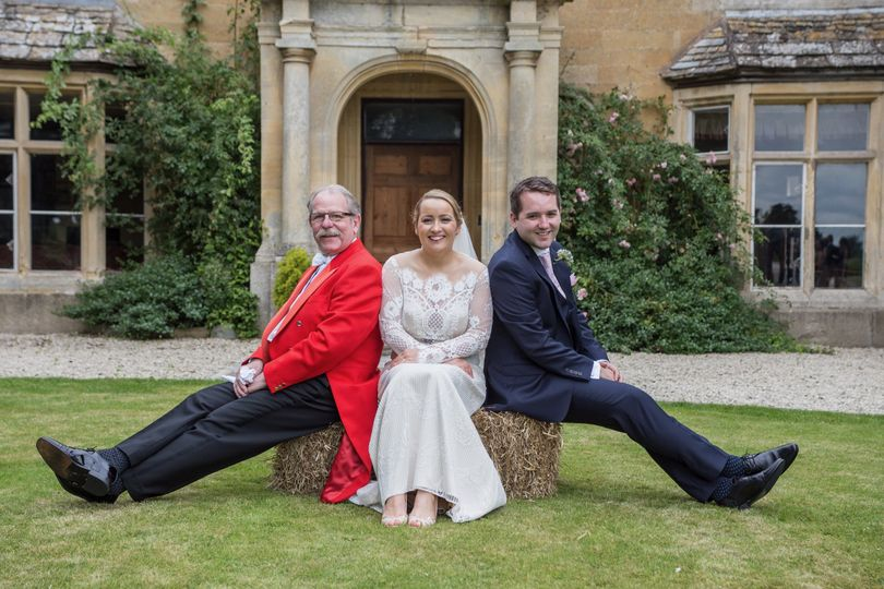 Newlyweds with their toastmaster