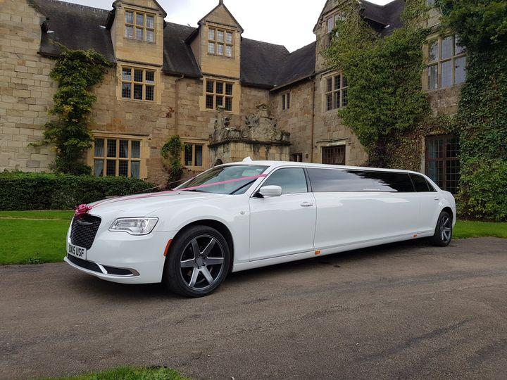 White stretch limousine