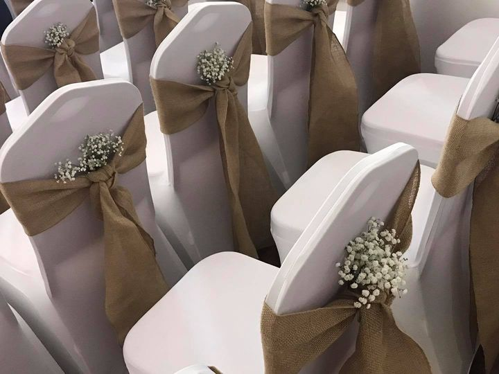 Rustic chair covers and sashes