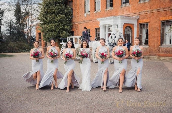 Bride and bridesmaids in front of the Manor House