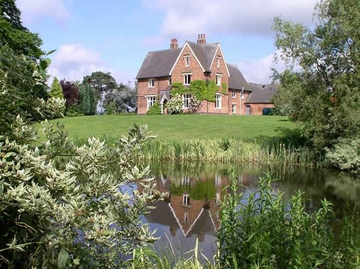 Farmhouse from pond view