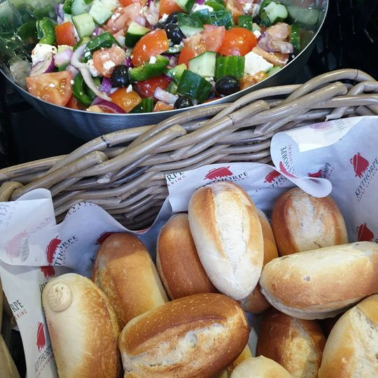 Greek salad and crusty baguettes