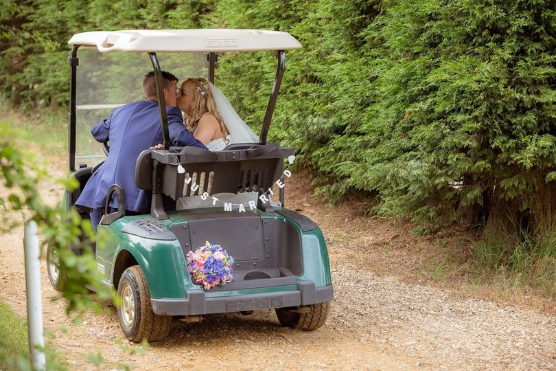 Married couple in golf buggy