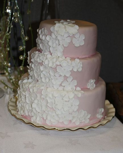 Pink cake with white blossom