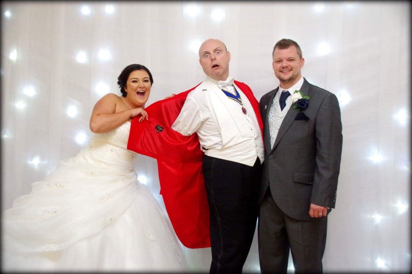 Newlyweds and their toastmaster