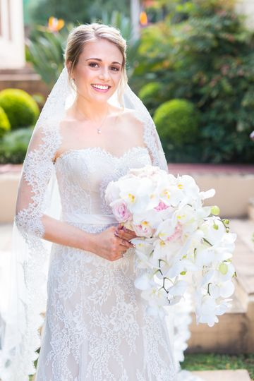 Newlywed with cascading bouquet