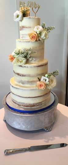 Four-tiered cake with flowers