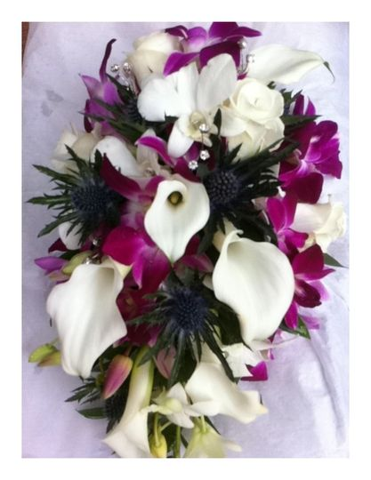 Cal orchid and thistle bouquet