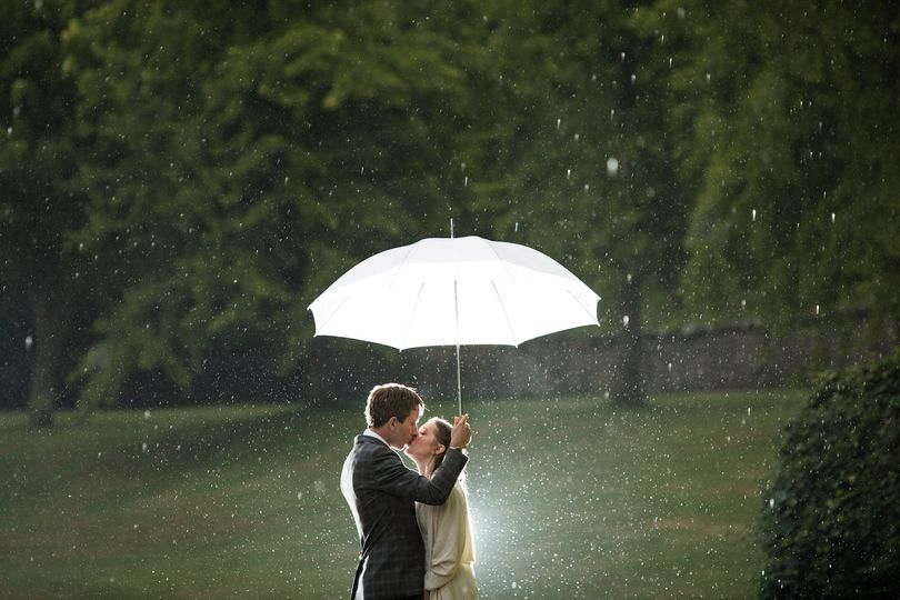 Kissing under the umbrella - Philip Bedford Wedding Photography