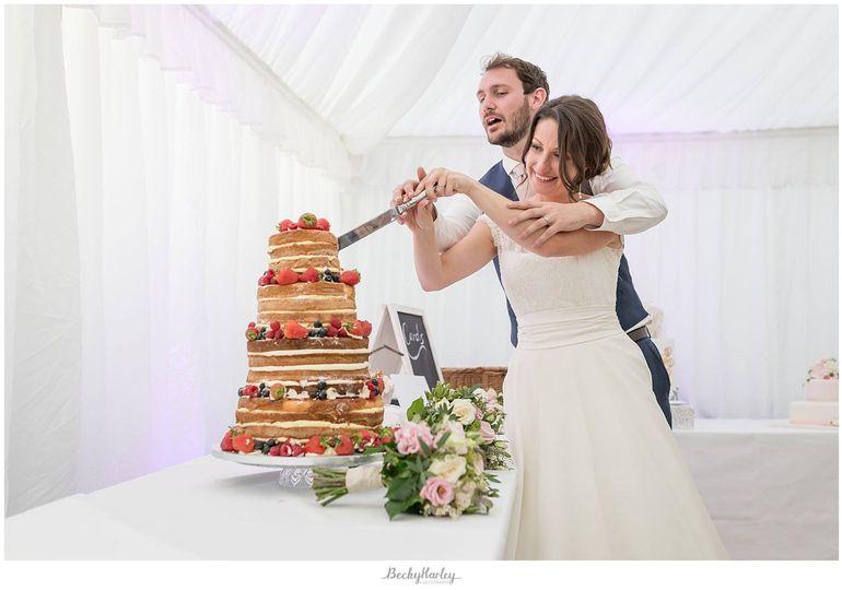 Newlyweds cutting the cake