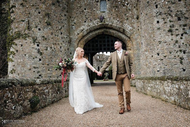 Couple holding hands - Kevin Watkins Wedding Films